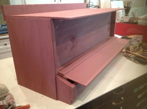 Nesting boxes were built separately inside - then mounted at an angle on the outside of the hen house.
