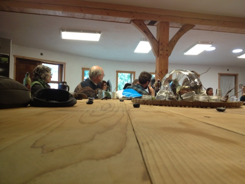 The massive round table in the Zero Mile Eatery at OUR Ecovillage was the perfect piece of furniture to facilitate the discussion about community farming...