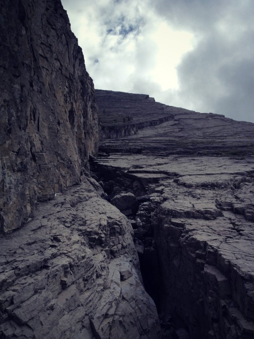 Looking up the slab - though mostly smooth, every now and then a dramatic crack opened in the rock before us